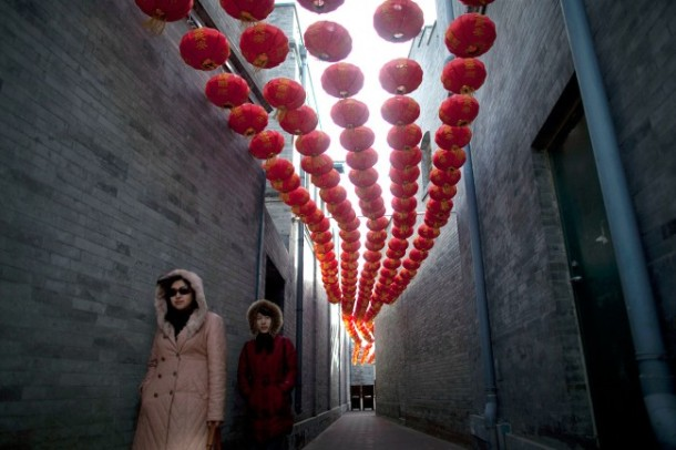 Tourists-walk-through-an-alley-decorated-with-red-lanterns-for-the-Lantern-Festival-in-Beijing-on-February-6-2012.-AP-PhotoAlexander-F.-Yuan-650x433