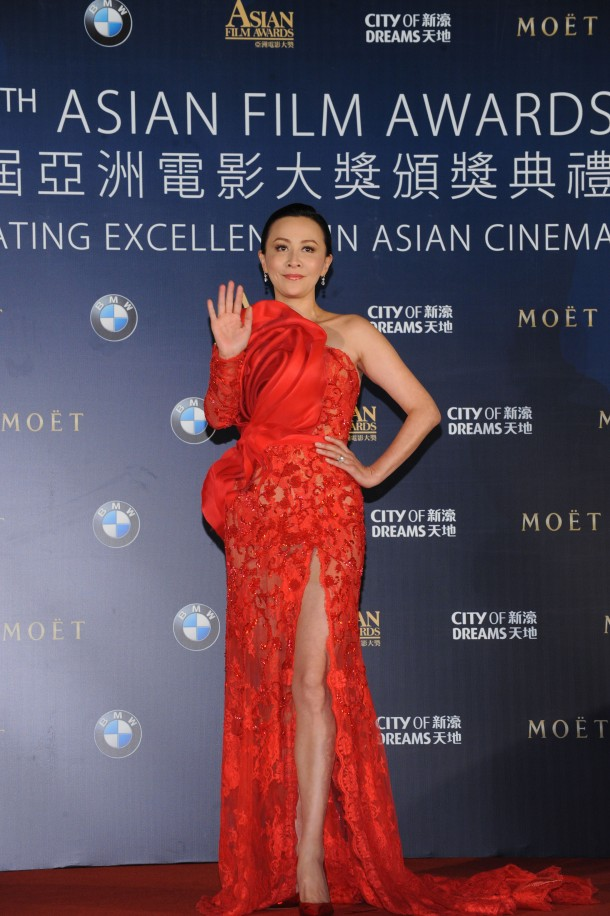 Ms Carina Lau, celebrity juror of the 8th AFA, arrives on the red carpet in a similarly bold red number