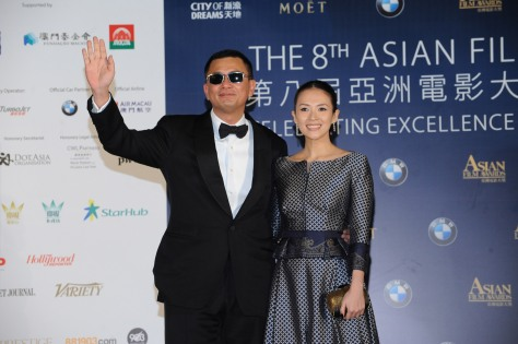 Wong Kar Wai arrives on the red carpet with Zhang Ziyi