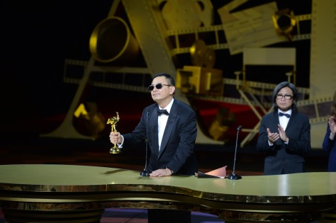 Wong Kar Wai, director of The Grandmaster, receives the award for Best Film from Peter Chan and Isabelle Huppert
