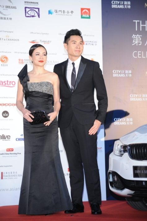 Yeo Yann Yann and Anthony Chen arrive together on the red carpet at the 8th Asian Film Awards