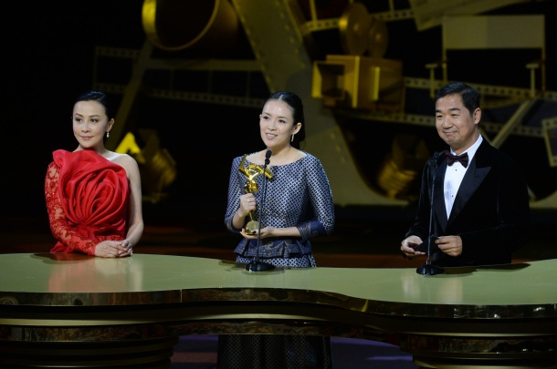 Zhang Ziyi receives the Best Actress Award for her performance in The Grandmaster from celebrity juror Carina Lau and
